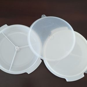 Two Tupperware Storage Containers